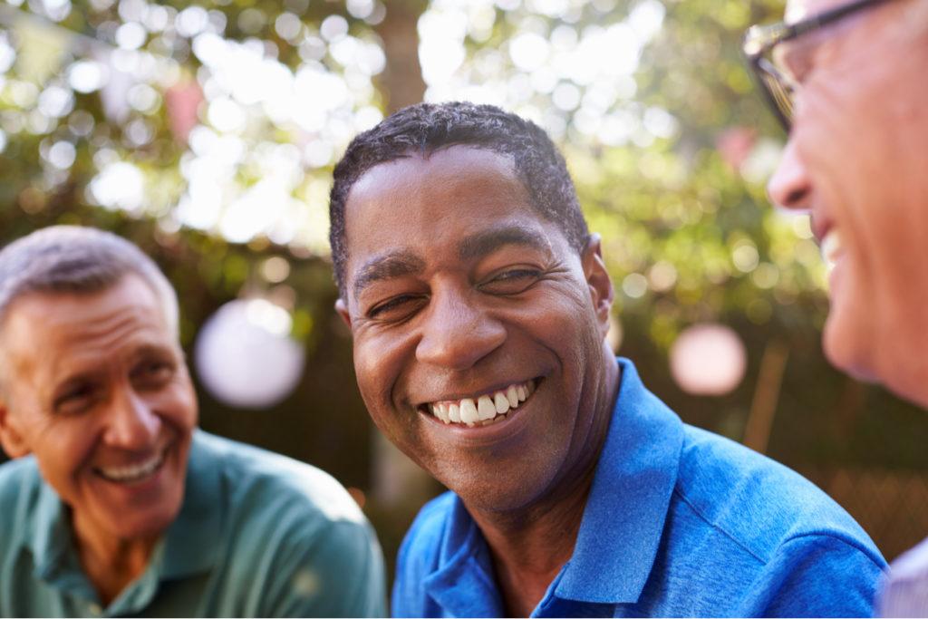 middle aged men smiling