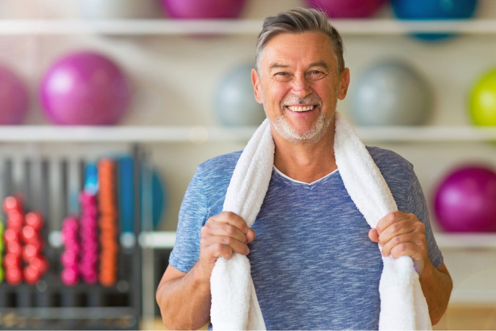 middle aged man happy about exercising