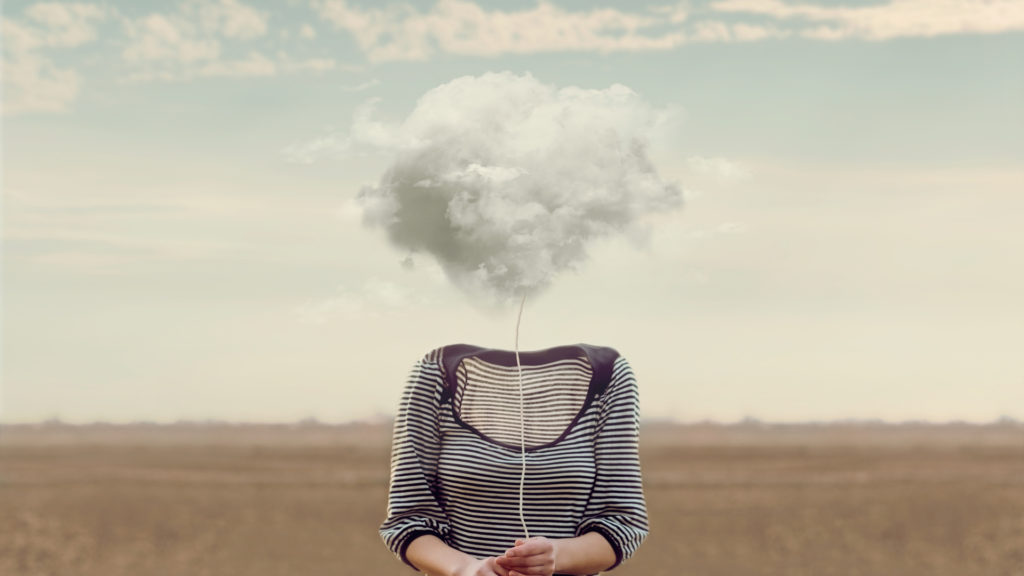 woman with her head in the clouds, brain fog
