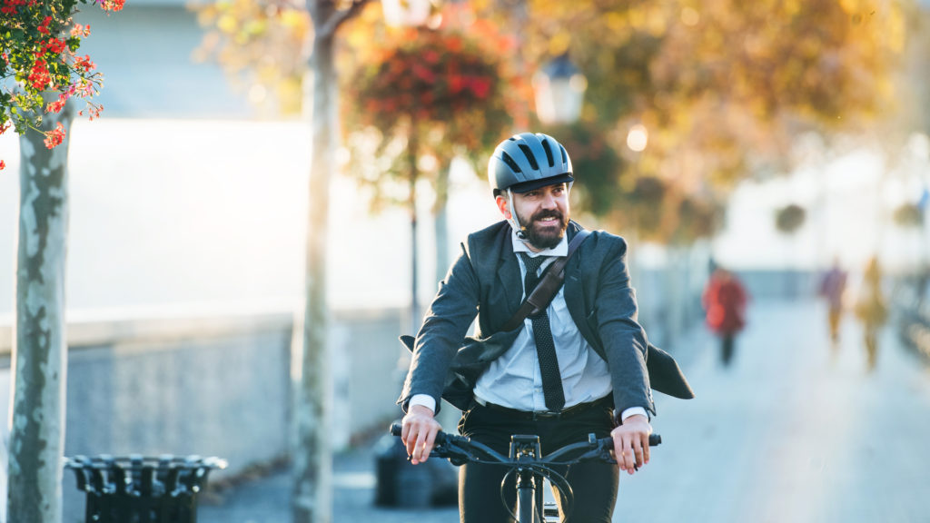 business man riding a bike for exercise to work