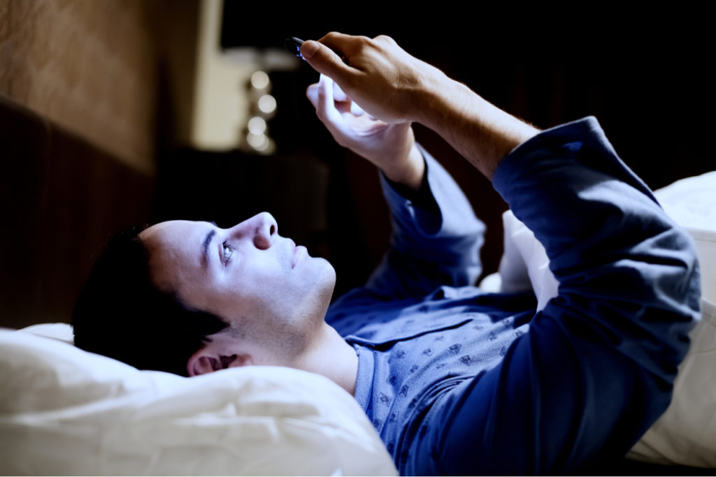 cell phone addiction - man up at night on phone