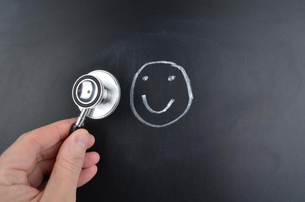 smiley face on blackboard