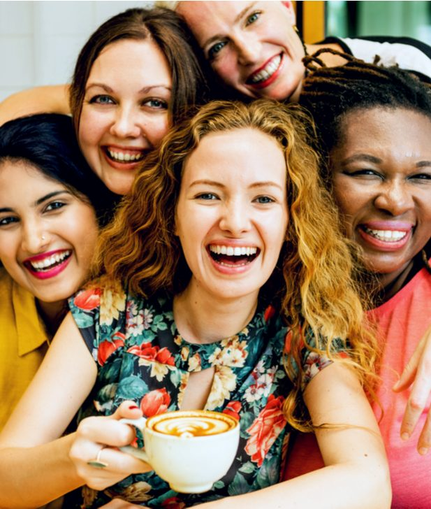 group of happy women enjoying coffee