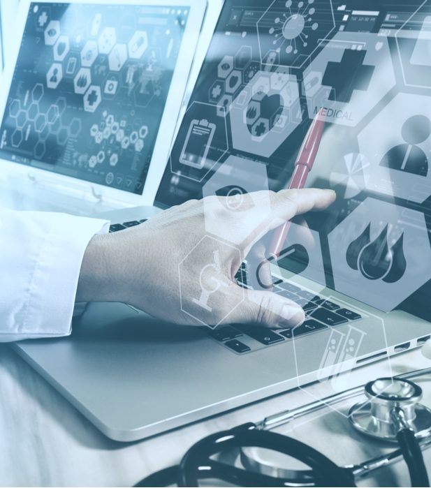 Healthcare provider pointing at a laptop