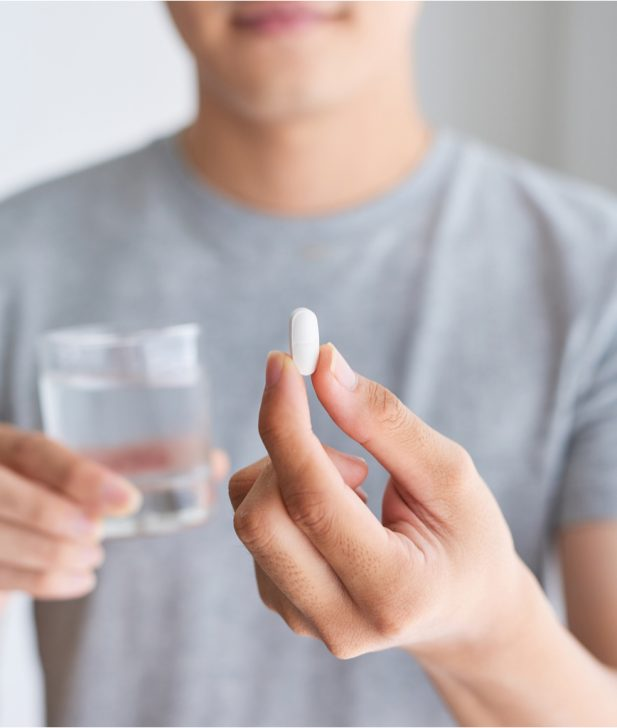 Patient holding a pill tablet